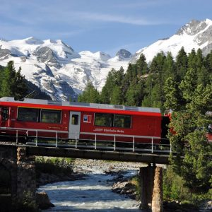Rhaetische Bahn/RhB - ALLEGRA-Triebzug Bei Morteratsch, Im Hintergrund Der Morteratsch-Gletscher.  Rhaetian Railway/RhB - An ALLEGRA Railcar Near Morteratsch, With The Morteratsch Glacier In The Background.  Ferrovia Retica/FR - Elettrotreno ALLEGRA A Morteratsch, Sullo Sfondo Il Ghiacciaio Di Morteratsch.   Copyright By Rhaetische Bahn   By-line: Swiss-image.ch/Tibert Keller